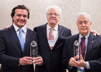 Guillermo E. Pepe, Guillermo Pepe, MD, and Richard N. Hirsh, MD, FACR, celebrate receiving the Global Humanitarian Award at ACR 2019.