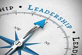 Compass needle pointing toward leadership